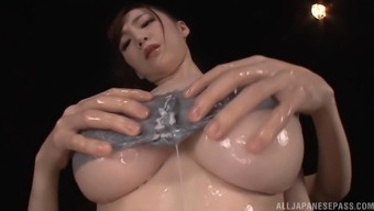 Sumire Mika shows off her amazing titties before sucking a angle