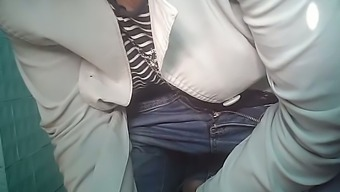 Mature light female in white denim and mens winter coats pisses in the wc