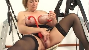 Grow older Rieky oiled pussy tapped seductively in BDSM