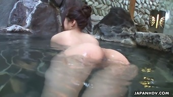 Blemished Oriental hen Rin Hitomi barbs on top of one unfamiliar person within a community tub