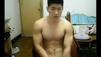 Burly Eastern hunk takes off his clothes and jerks off his prick