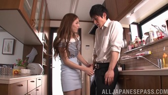 Japanese seductress sees to it he fucks her challenging in the cooking area