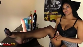 Perverted Ebony Date gives footjob and masturbates in stockings