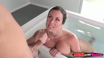 Busty vulgar dark wins a way to feed a enjoyable angle in bathroom