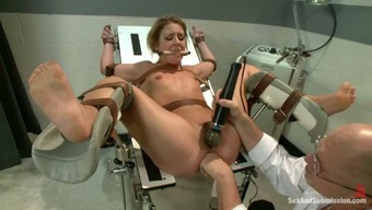 Held captive blond gets bound and fucked through a medical professional