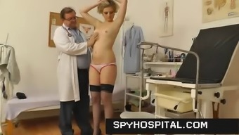 Older gyno doctor manages a concealed cam