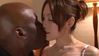Japanese hussy gets her pussy touched and broken by the dark colored stud
