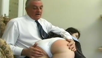 Schoolgirl underside spanked and caned