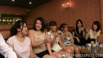 For a clubhouse a grouping of Japanese people women has group love-making along with weird males
