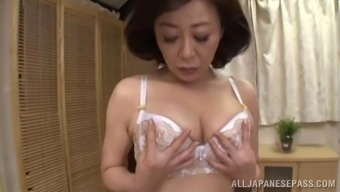 Parents should spunk too so this Far eastern MILF fingers her pussy