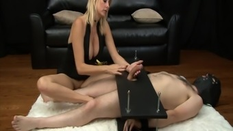 Mean MILF gives nasty femdom handjob to effectively penis in thrall