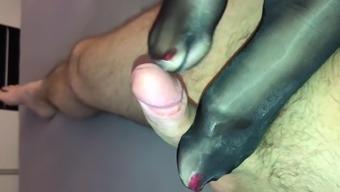 Horny glossy pantyhose both feet give warm footjob