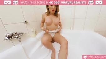 Busty tranny Bianka Nascimento masturbates inside the bath room