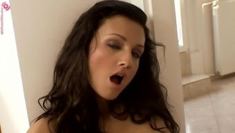 Aletta utilizes a black dildo in order to make her cunt soaked soppy