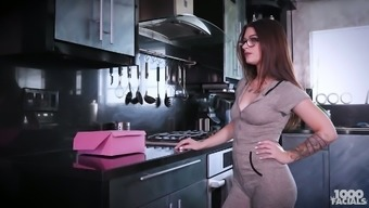 Babe in glasses Lacey Channing shows her tits and gives a yum-yum blowjob