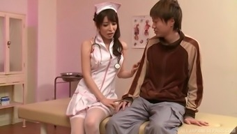Japanese honey Kazama Yumi pleases a friend by playing with his cock