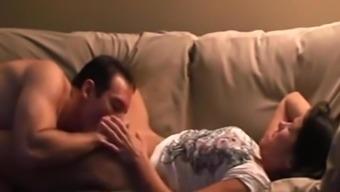 Vehement sex with partner toward the settee