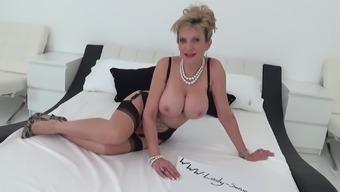 Mature British blonde Lady Sonia masturbating