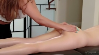 Stunning babe Judy Jolie oils up and finger fucks pussy of sex-appeal client on the massage table