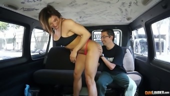 Female bodybuilder Karyn shows her fake big boobs in the back seat