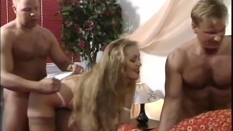 Busty milf is getting fucked by two men