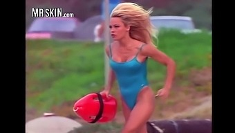 Busty babe Pamela Anderson running in her iconic red Baywatch swimsuit