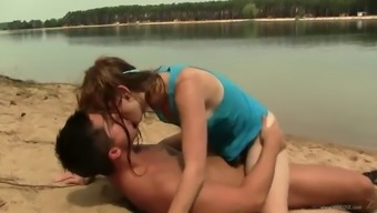 cutie gets fucked by some dude on the beach
