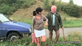 Lovely babe seduces grandpa on the road