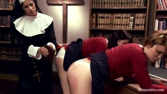 Attractive nun dominates a couple of sexy babes at college unvarying