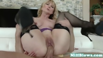 mature with large breasts fucks playful bloke sitting down on the sofa